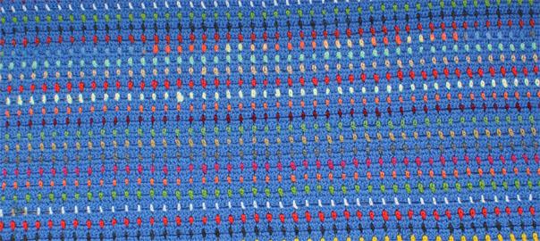 Manta de ganchillo para niños con restos de lana